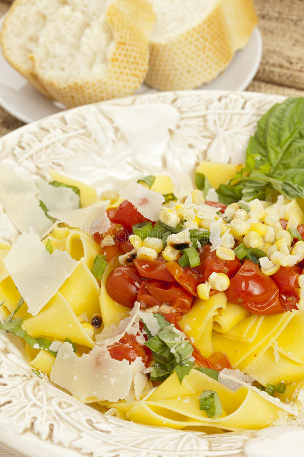 Pappardelle Pasta with corn and tomatoes stock photo