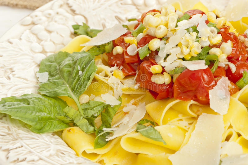 Pappardelle Pasta with corn and tomatoes royalty free stock image