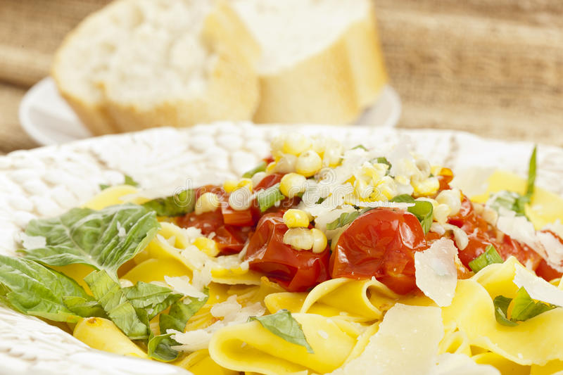 Pappardelle Pasta with corn and tomatoes stock images