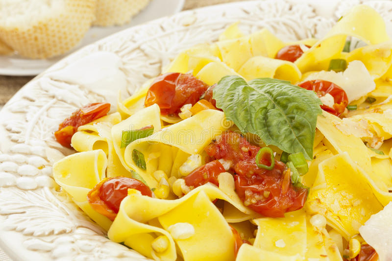 Pappardelle Pasta with corn and tomatoes royalty free stock photography