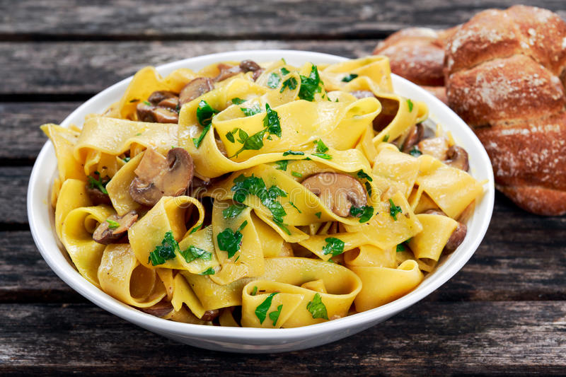 Pappardelle Pasta with mushrooms and other herbs royalty free stock image