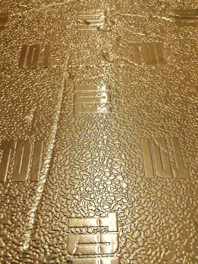 Papper med guld- bakgrund arkivfoto