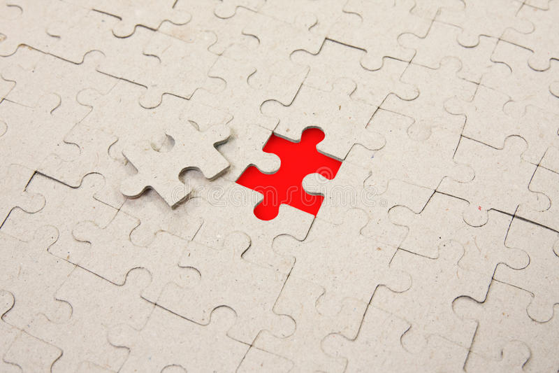 Papper Puzzle With  Red Piece Missing Royalty Free Stock Photography