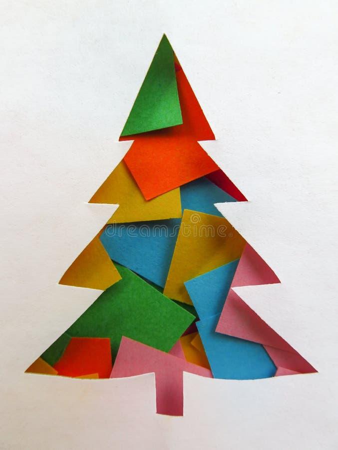 Pappers- färgrikt granträd - arkivfoton