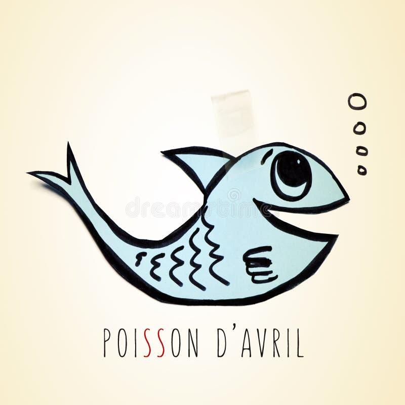 Pappers- fisk- och textpoisson D avril, dag för april dumbommar i franskt royaltyfri foto