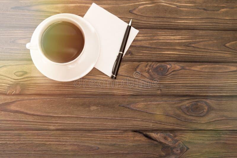 Pappers- servett för kopp kaffebollpenna royaltyfri bild