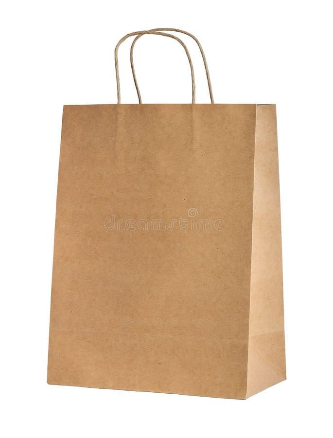 Pappers- shoppingpåse för beiga royaltyfri foto