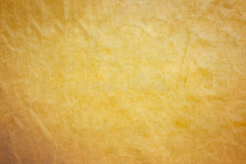 Pappersbakgrund för gammal guld royaltyfria bilder