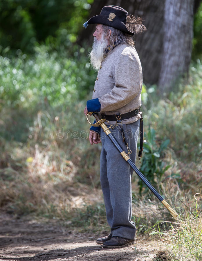 Pappy Walton. Civil War era Confederate soldiers at attention during the Dog Island reenactment in Red Bluff, California royalty free stock photo