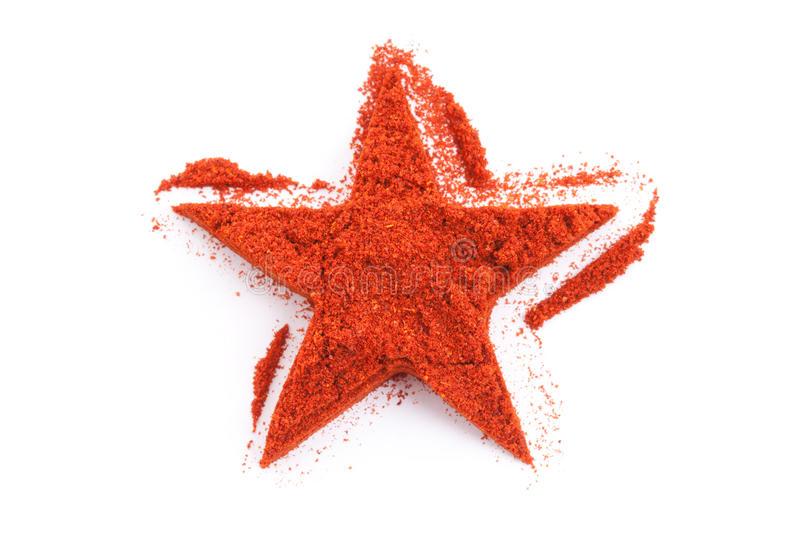 Paprika isolated in star shape on white royalty free stock photography