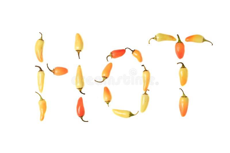 Paprika-Pfeffer, die das Wort H O T formulieren lizenzfreie stockfotos