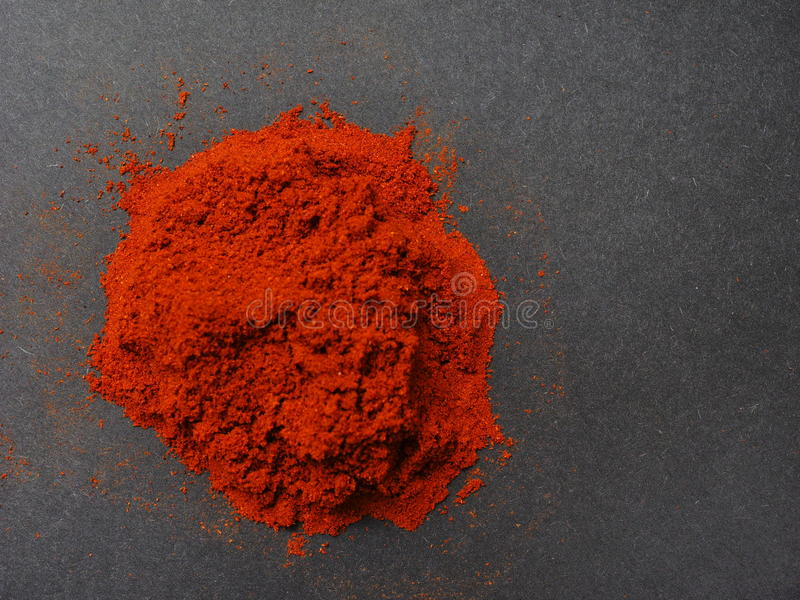 Paprika powder. On a black background with copy space to the right stock photography