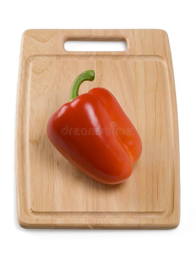 Paprika roja en la tarjeta de la cocina imágenes de archivo libres de regalías