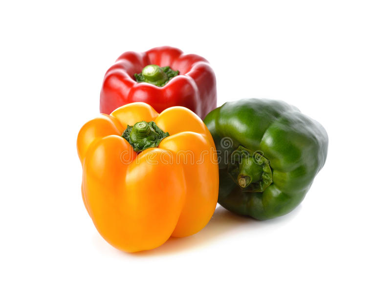 Paprika rouge, jaune, vert sur le blanc photo libre de droits