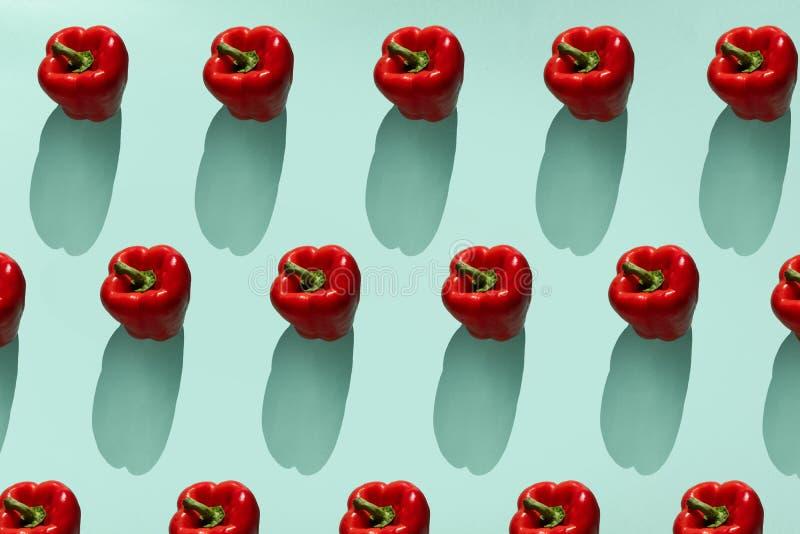 Paprika vegetable  pattern. Colorful of fresh paprika on blue background.  Photography collage. Minimal summer vegetables pattern. stock images