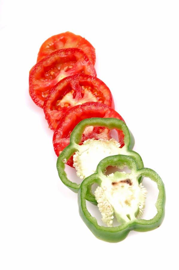 paprikan skivar tomaten arkivbild