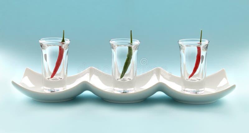 Paprikas in den Schuss-Gläsern lizenzfreie stockfotos