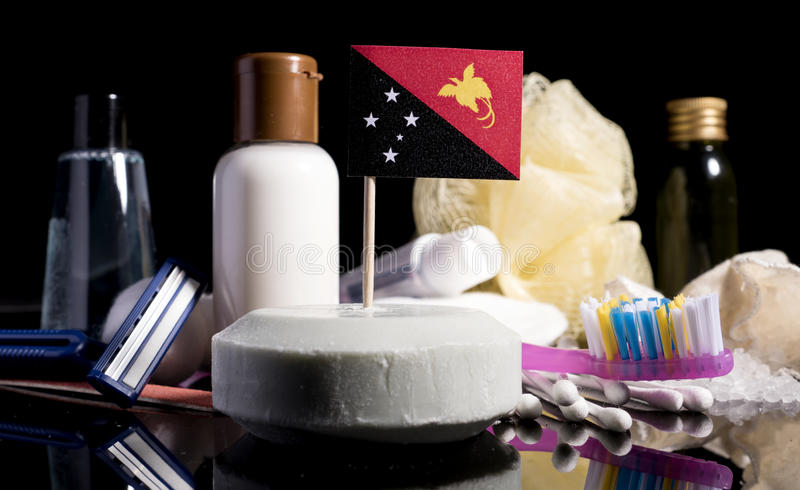 Papua New Guinea flag in the soap with all the products for the. People hygiene royalty free stock image