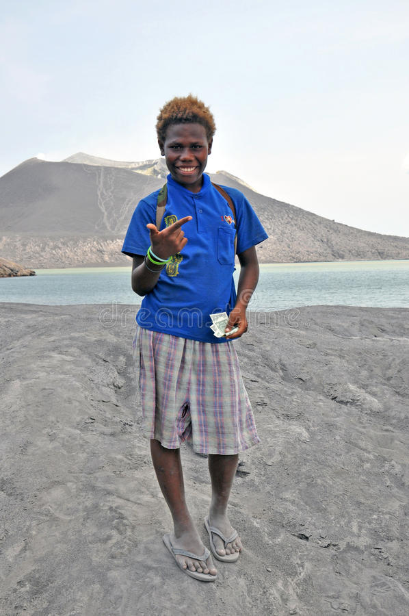 PAPUA NEW GUINEA PEOPLE. Boyish looking girl posing and smiling, Rabaul, Papua New Guinea royalty free stock images