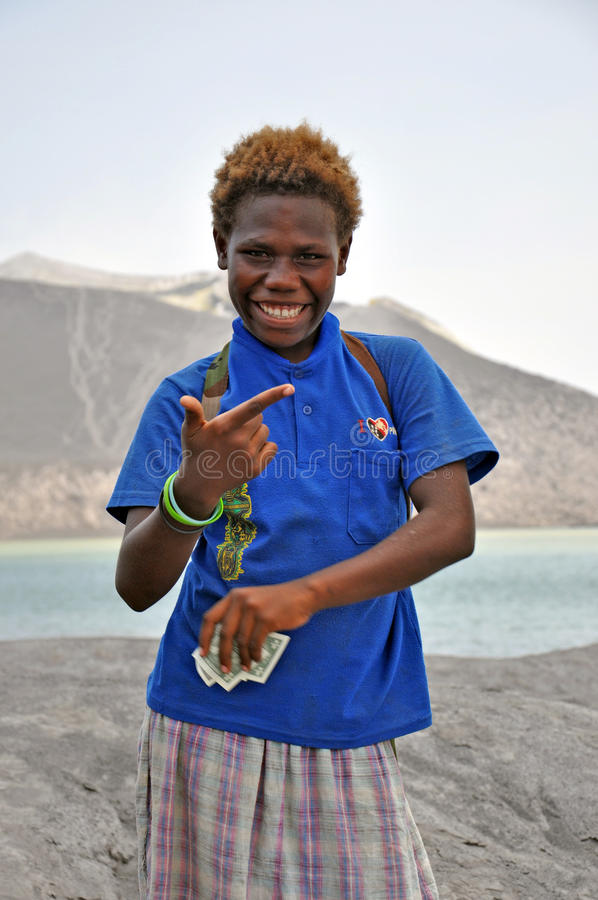 PAPUA NEW GUINEA PEOPLE. Boyish looking girl posing and smiling, Rabaul, Papua New Guinea stock image