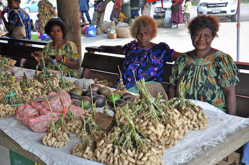 PAPUA NEW GUINEA PEOPLE. Food market, Rabaul, Papua New Guinea royalty free stock photo