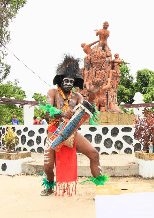 Papuan in tribe clothes stock photos