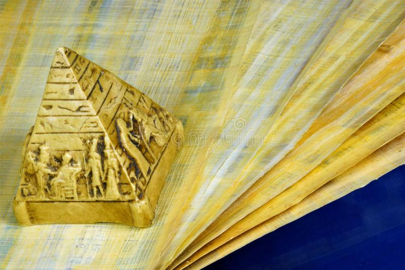 Papyrus ancient Egyptian canvas, writing material and pyramid. Papyrus - canvas for crafts, abstract texture of Egyptian papyrus, stock image