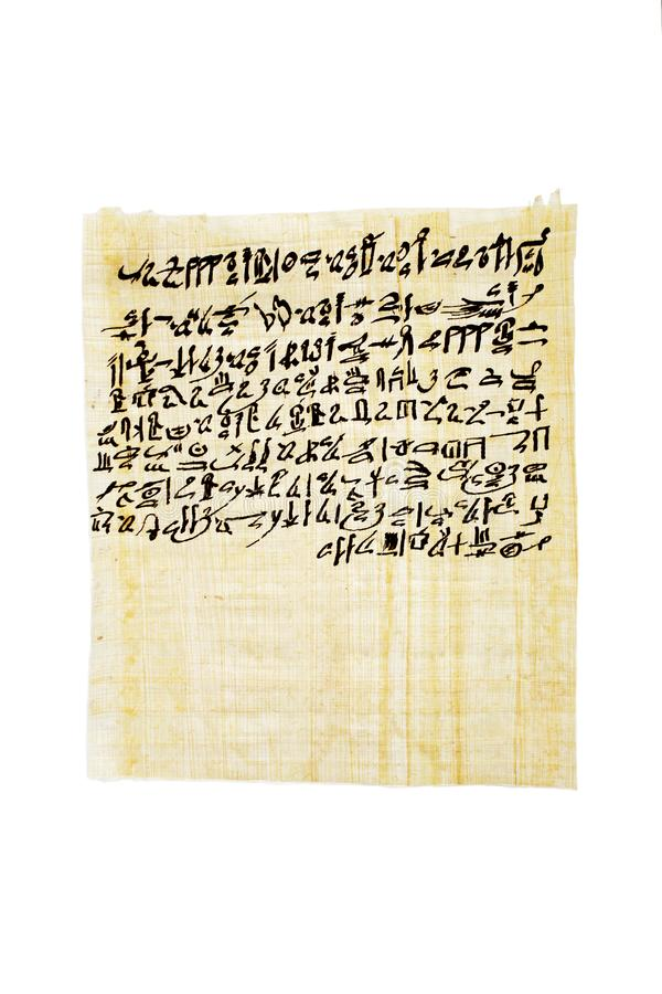 Papyrus containing the anthem of Sekhmet-Bast, daughter of Ra Egyptian Book of the Dead, chapter CLXIV 164 in hieratika. Handpainted with ink now. Isolated stock photo