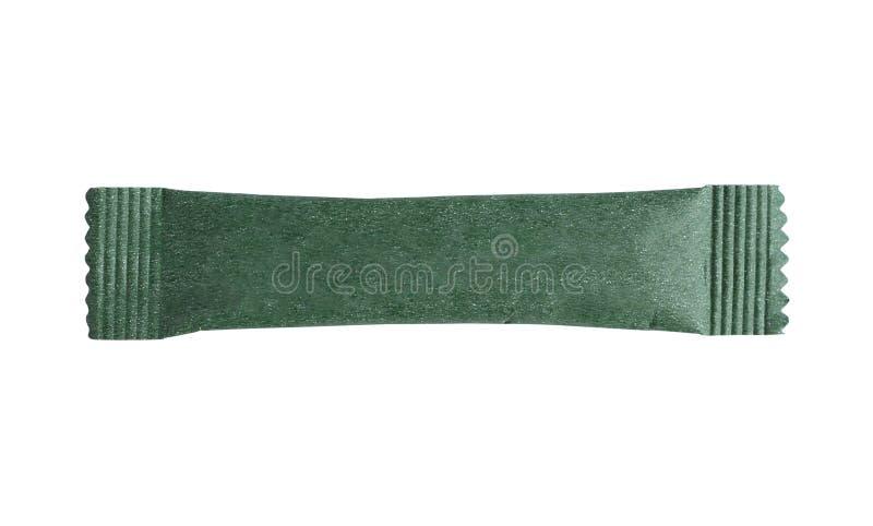 Paquet vert vide de sachet de bâton d'isolement sur le blanc photo stock