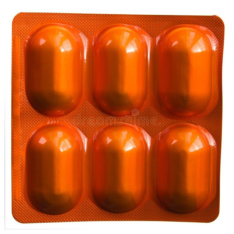 Paquete de ampolla anaranjado de las píldoras fotos de archivo