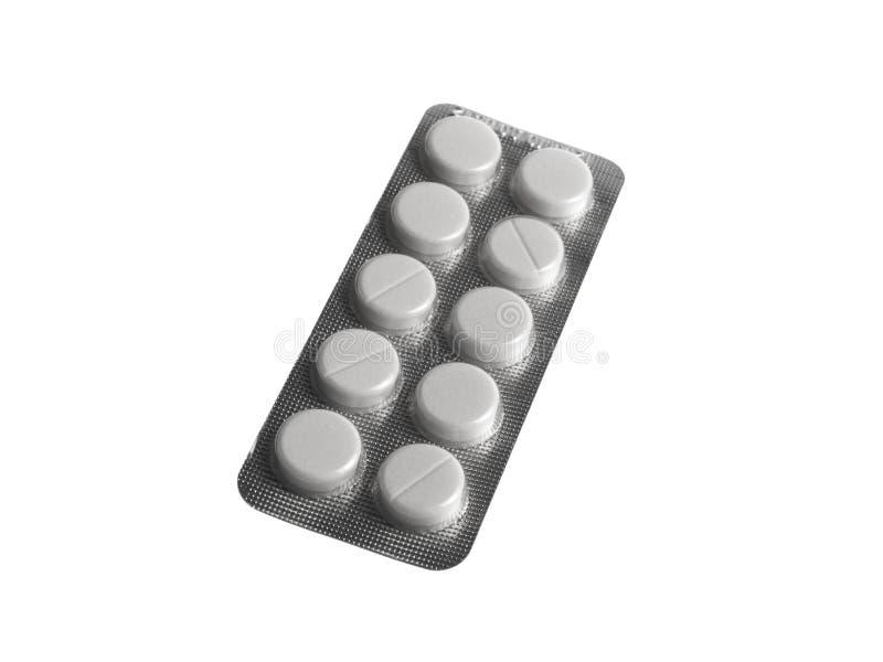 Paquete de ampolla de píldoras en el fondo blanco foto de archivo
