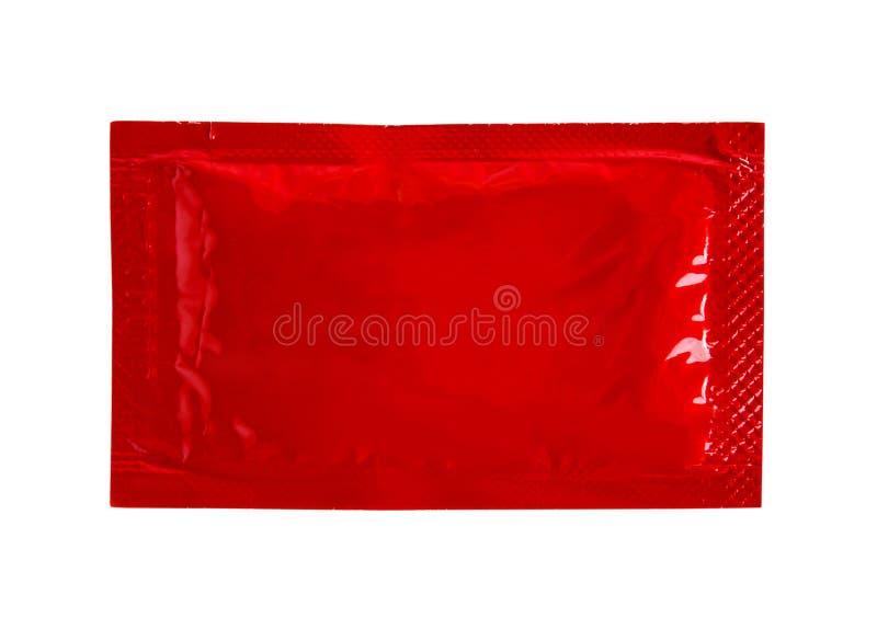 Paquete de la salsa de tomate de la salsa de tomate foto de archivo