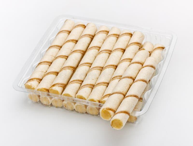 Paquete poner crema curruscante de los palillos fotografía de archivo