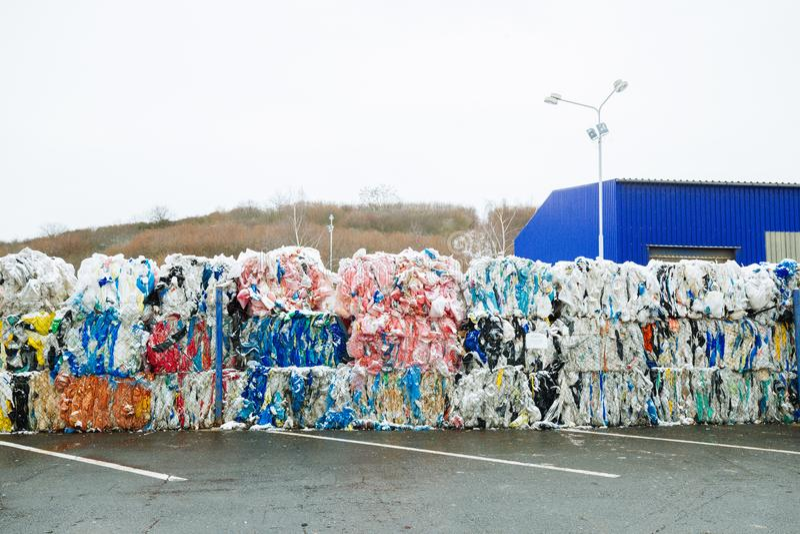 Paquetes y acción de dedicado plástico envuelta del pedazo para Eco Recy fotografía de archivo