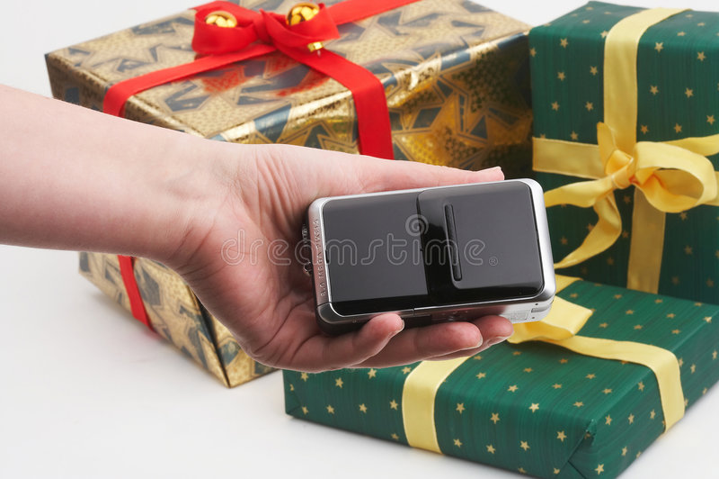 Paquets de cadeau d'achats de Digicam photo libre de droits