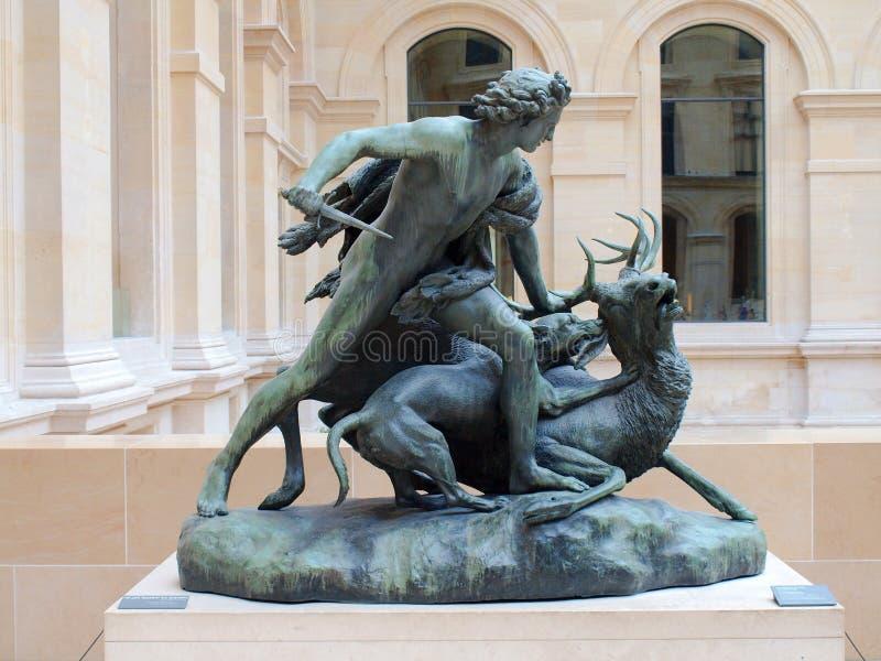 Escultura del cazador en el museo del Louvre. 21 de junio de 2012. París foto de archivo