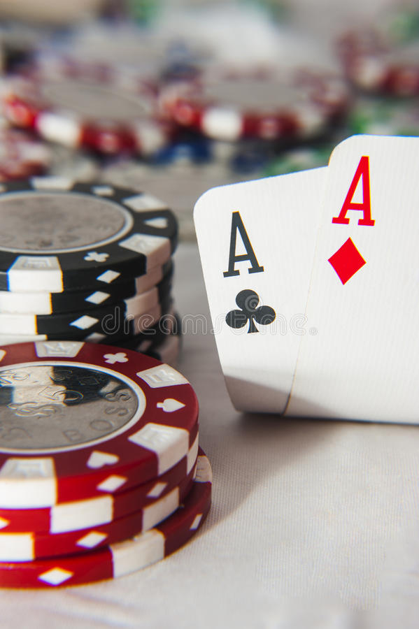 Pair of aces in front of poker chips royalty free stock photos