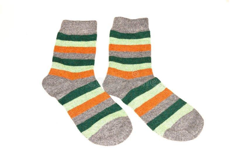 Par av randiga sockor på vit bakgrund royaltyfri fotografi