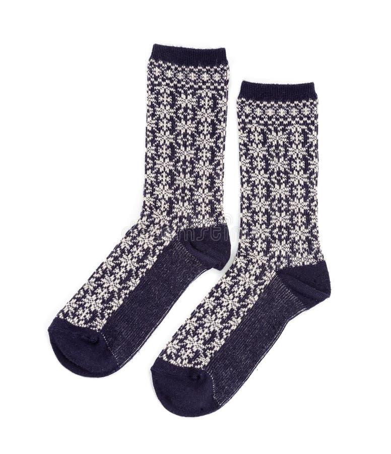 Par av sockor för att bekläda som isoleras på vit bakgrund arkivfoton