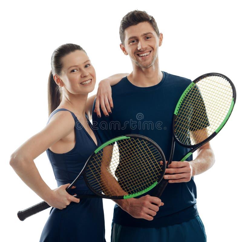 Par av unga tennisspelare royaltyfri bild