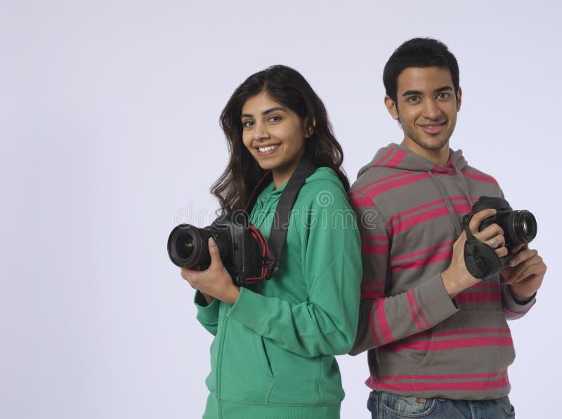 Par med kameror i studio arkivbilder
