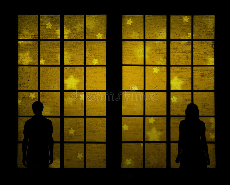 Par med kulör xmas-bakgrund för guld arkivbild