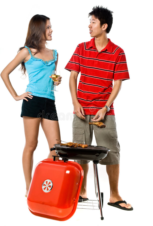Par och BBQ arkivfoto