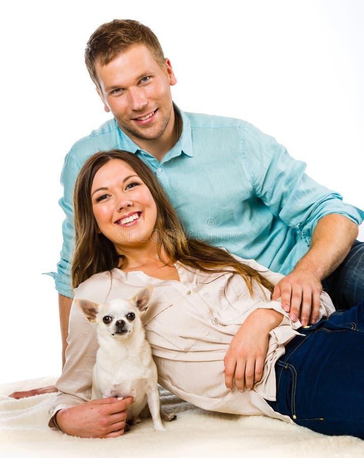 Par och hund royaltyfri bild