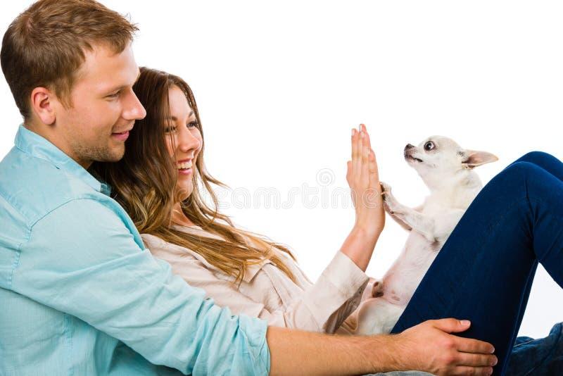 Par och hund royaltyfria foton