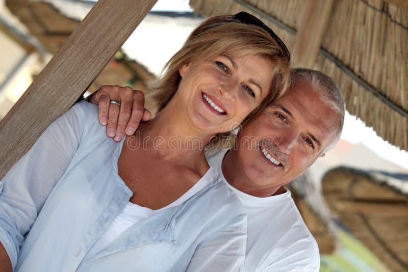 Par på exotisk ferie fotografering för bildbyråer