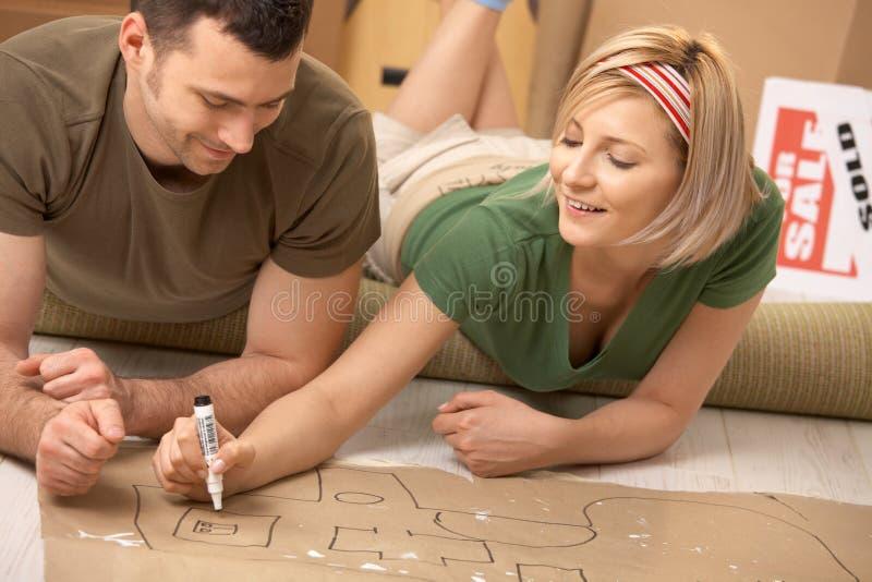 par returnerar den deras nya planläggningen royaltyfri bild
