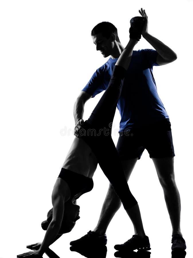 par som övar mankvinnagenomkörare arkivfoto