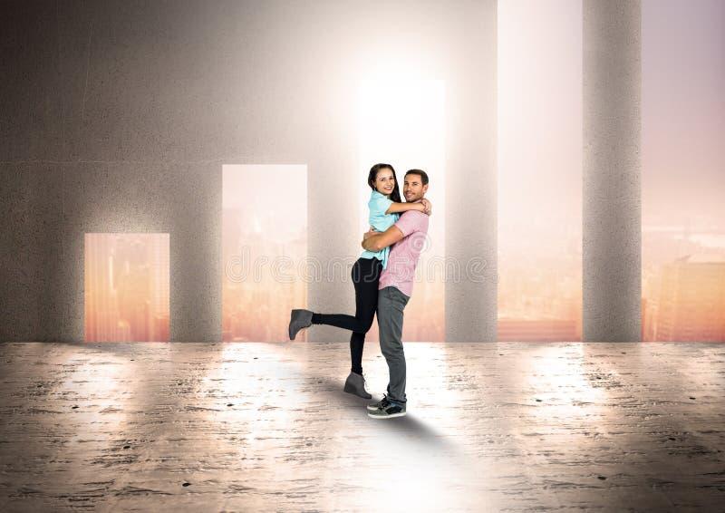 Par som omfamnar mot formade dörröppningar för stånggraf arkivfoton