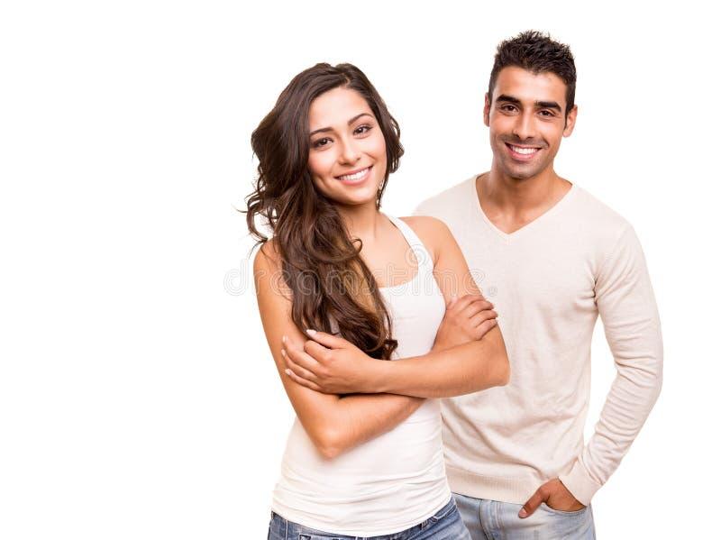 Par som poserar över vit bakgrund arkivfoton